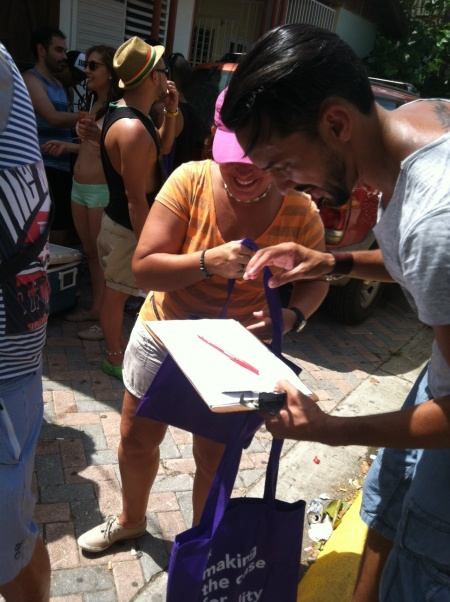 It was hot and sunny, but folks were curious about the purple Making the Case for Equality bags from Lambda Legal and were happy to donate three minutes to complete our health survey.